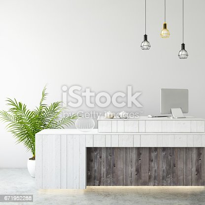 648050486istockphoto interior office lobby desk with large PC monitor and a blank wall 671952288