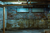 Interior of old grungy warehouse basement.