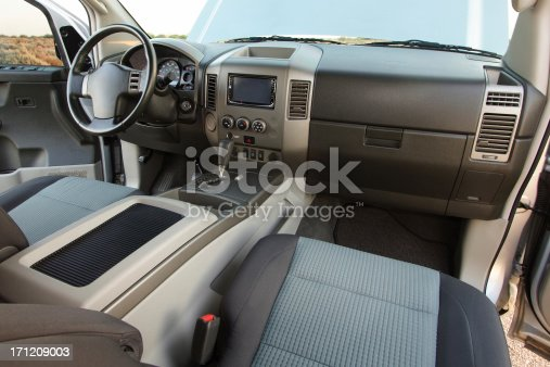 Spacious interior of an SUV or full size truck. Choose another iStock image to place in the monitor at the center of the dash! Canon 20D, 10-22mm lens, flash.