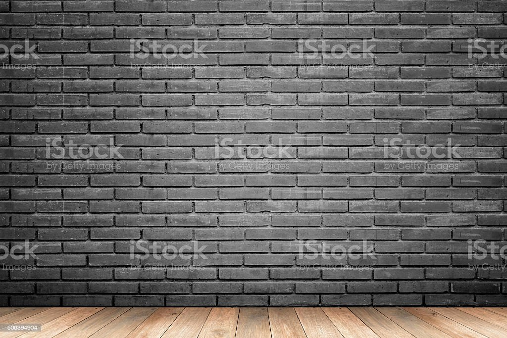 interior room with  black brick wall and wooden floor stock photo