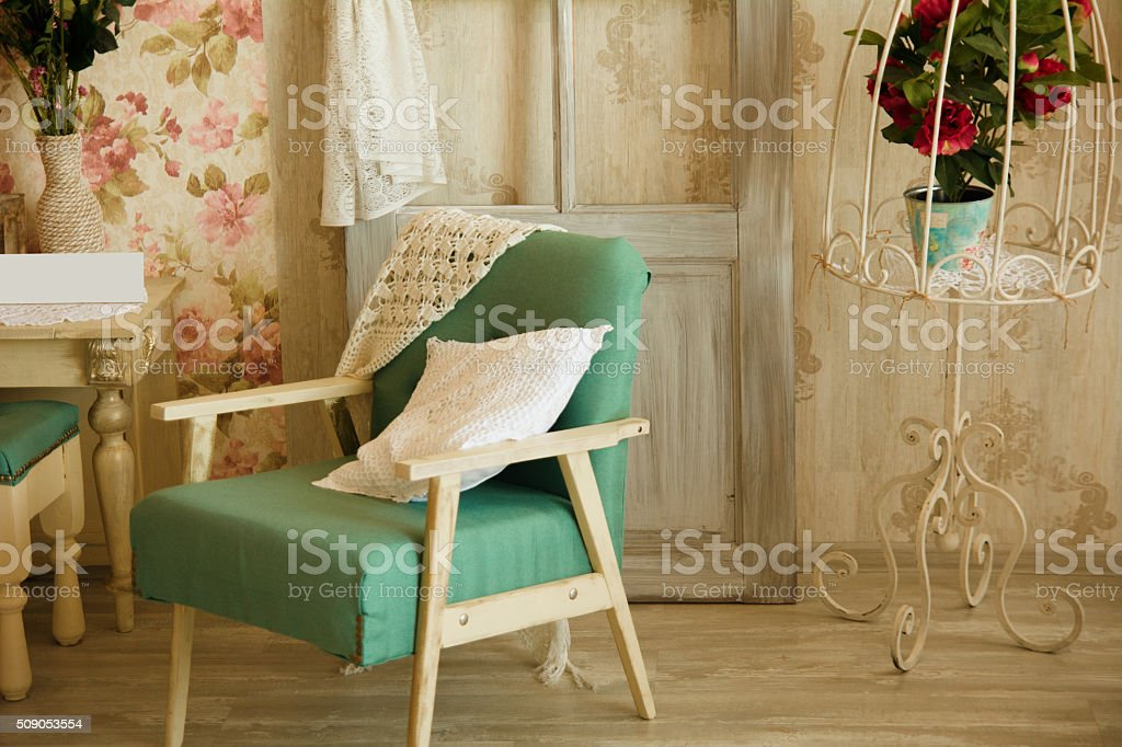 Interior room with chairs, pillows, door and flowers stock photo