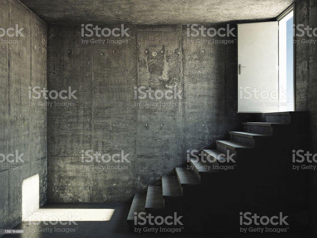 Quarto Interior com parede de concreto e escadas - foto de acervo