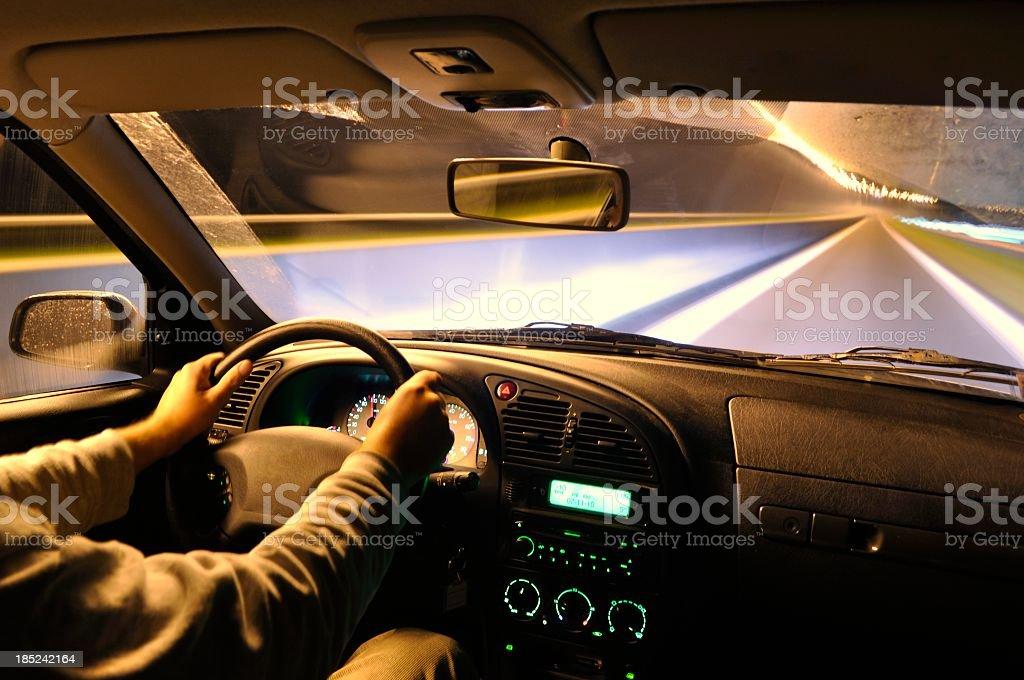 Interior shot of a car driving at night royalty-free stock photo