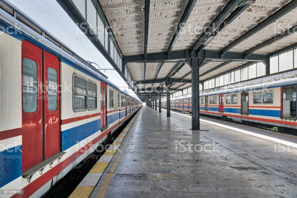 Interior shot of Haydarpasha Railway Terminal featuring metal truss and two colored stopped trains, Kadikoy, Istanbul, Turkey stock photo