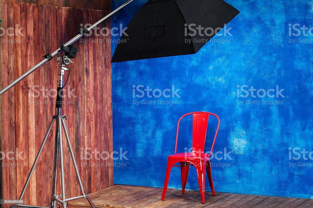 Interior studio - Red chair on a blue orange background stock photo