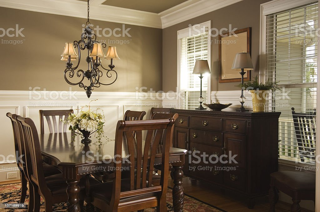 Interior view of a dining room with wooden furniture stock photo