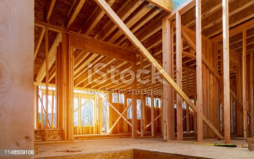 Interior view of a house under construction home framing