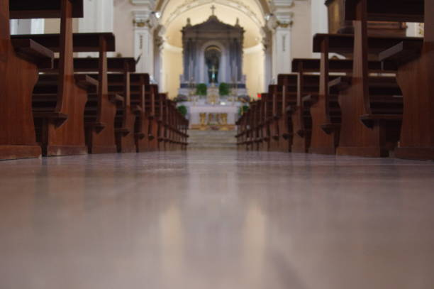Interior view of a modern church with empty pews stock photo
