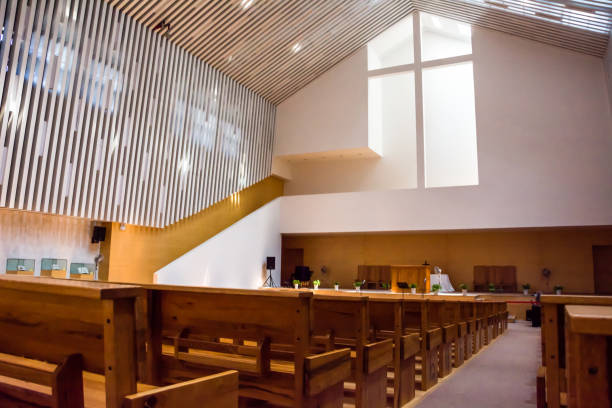 interior view of a modern church with empty pews - church stock photos and pictures