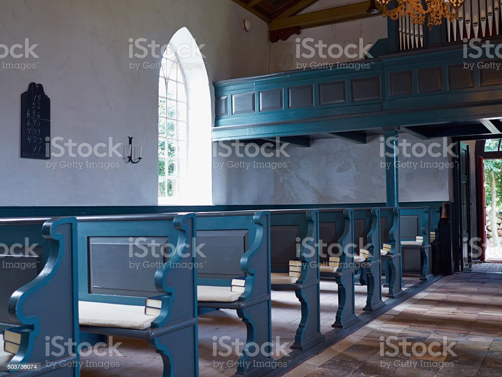 Interior view of a traditional church with empty pews stock photo