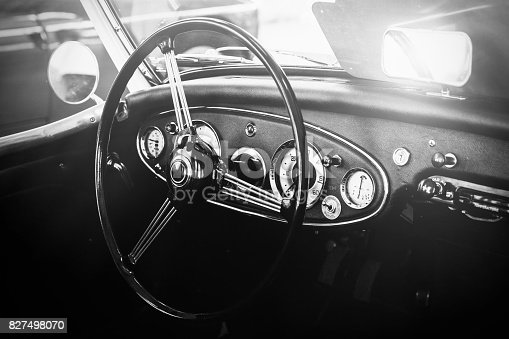 istock Interior view of classic vintage car. Instagram toning. Beautiful retro car poster, postcard. 827498070