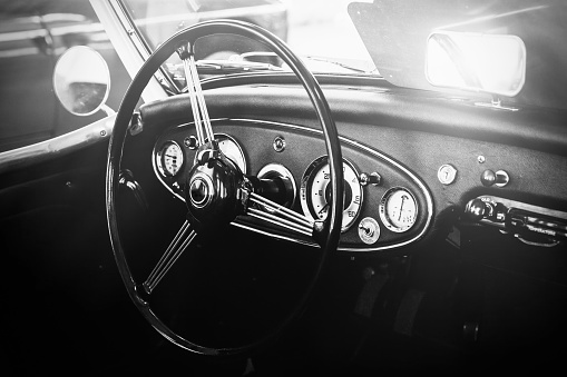 istock Interior view of classic vintage car. Instagram toning. Beautiful retro car poster, postcard. 827498070
