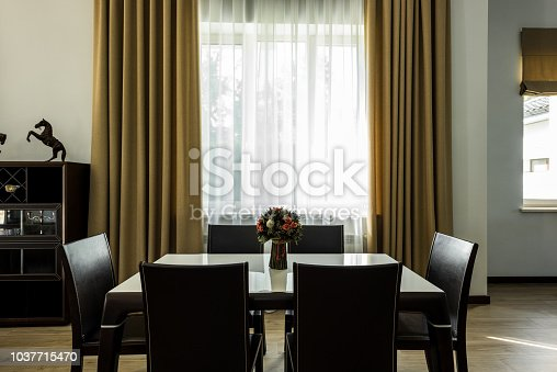 istock interior view of stylish dining room with table, chairs and big window 1037715470