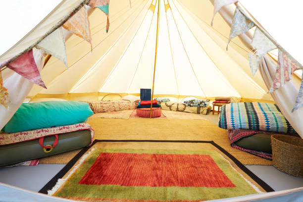 Interior View Of Teepee Tent Pitched On Glamping Camp Site With No People stock photo