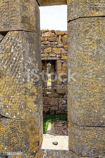 914134406 istock photo Interior view of the ruins of the medieval church of Killilagh through a stone window in the village of Doolin 1158177457