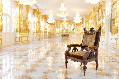 interior view of vintage wooden chair in luxury mirror room or hall decorated with chandelier, nobody