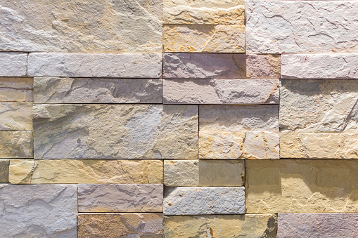 905087856 istock photo Interior wall made by stone tiles 500218216