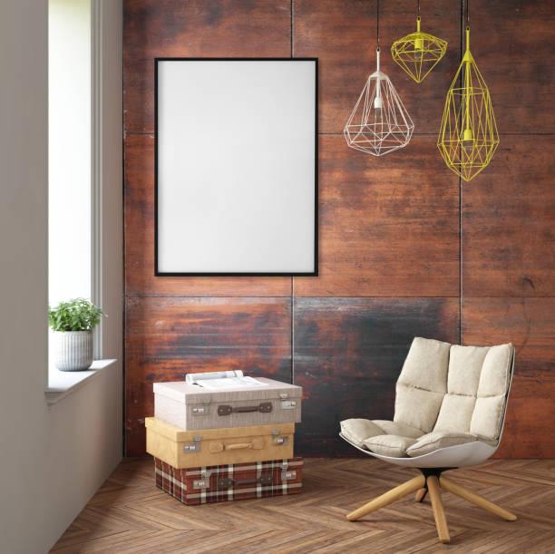 innenraum mit sessel und bild rahmen an der wand - zeitschrift wandkunst stock-fotos und bilder