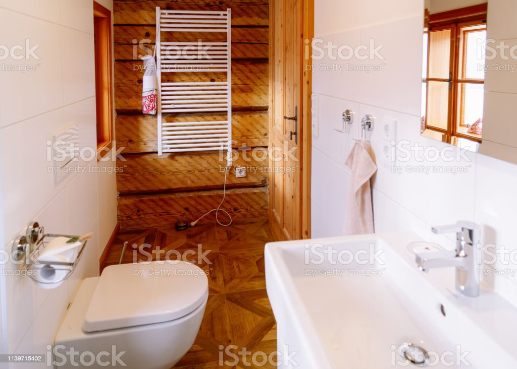 Interior with modern white bathroom with wood design. Home with...