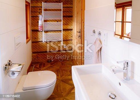 819534860istockphoto Interior with modern bathroom wood design toilet bowl sink mirror 1139715402