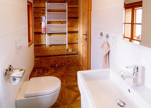 800987054 istock photo Interior with modern bathroom wood design toilet bowl sink mirror 1139715402