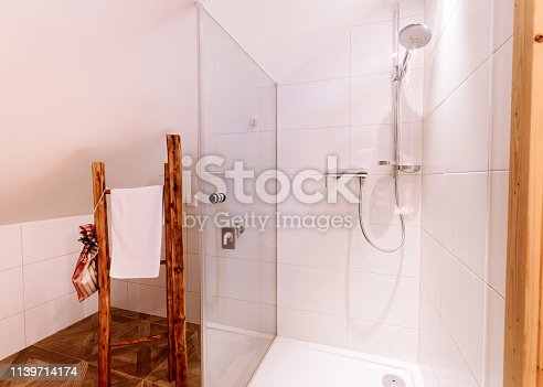 618327092istockphoto Interior with modern white bathroom with wood design shower 1139714174