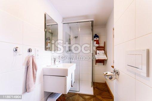 819534860istockphoto Interior with modern white bathroom with wood design sink shower 1139714904