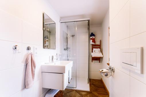 800987054 istock photo Interior with modern white bathroom with wood design sink shower 1139714904