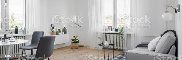 Interior with sofa and table picture id1158782217?b=1&k=6&m=1158782217&s=612x612&h=cziiwhezczq9h sy4qs ezqzi67wxg6j wc lwj73yg=