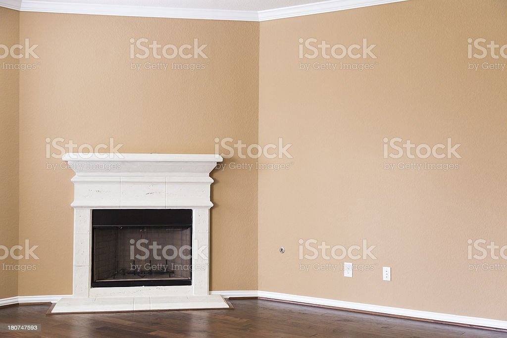 Interiors: Fireplace in room of new home. Off, no flame. royalty-free stock photo