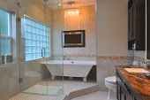 Interiors of luxurious bathroom with a marble tabletop
