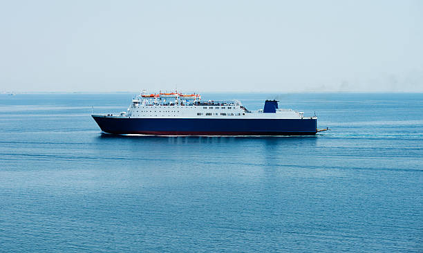interisland ferry in a distance - veerboot stockfoto's en -beelden