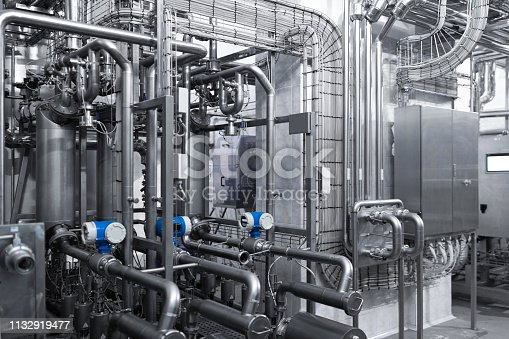 1132919442istockphoto Interlacing of metal pipes. Can be used as a background 1132919477