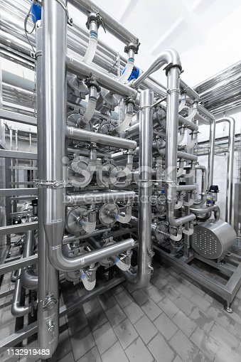 1132919452istockphoto Interlacing of metal pipes. Can be used as a background 1132919483