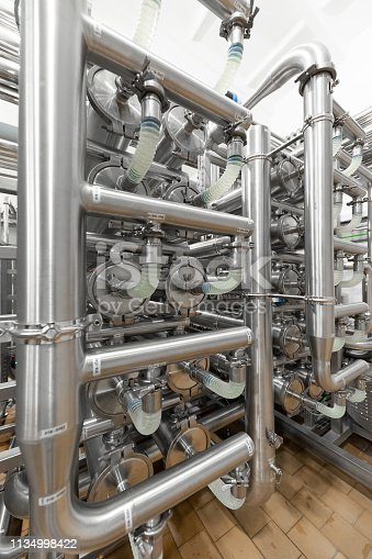 1132919452istockphoto Interlacing of metal pipes. Can be used as a background 1134998422