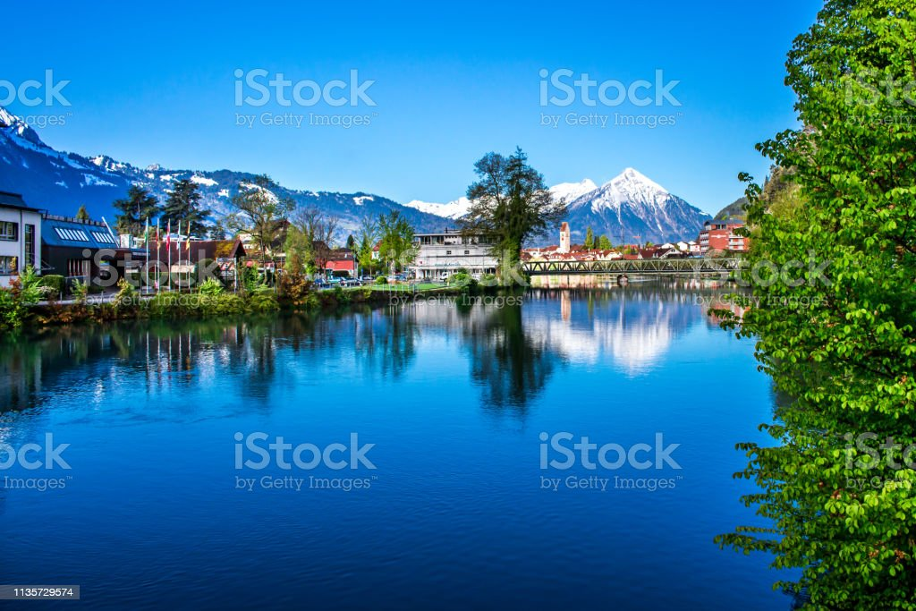 Interlaken Switzerland. One of the most beautiful places to visit Such a beautiful landscape in this city! If you love nature you certainly will love this city! Architecture Stock Photo