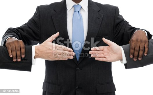 Businessman holding two businessmen separated hands