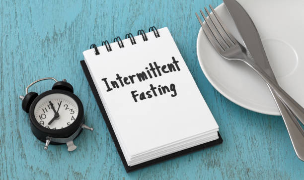 Intermittent fasting concept on blue table stock photo