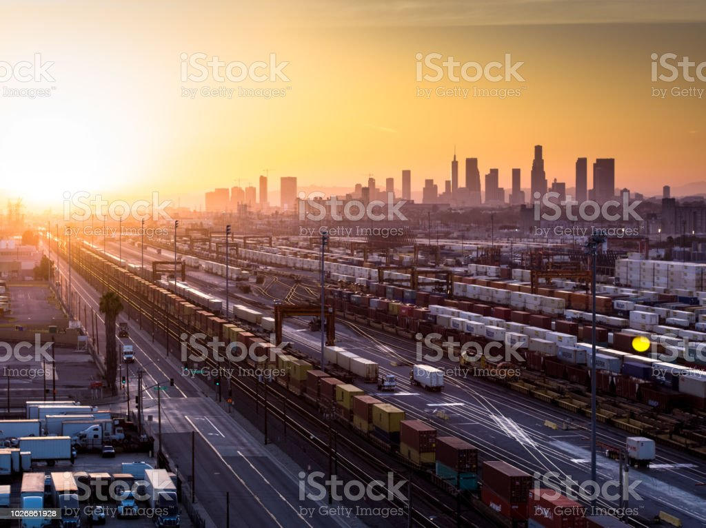 Intermodal Freight Yard with Los Angeles Skyline at Sunset stock photo