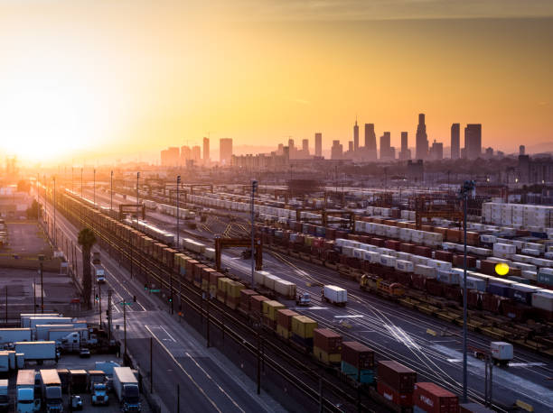 intermodal freight yard with los angeles skyline at sunset - halbergman stock pictures, royalty-free photos & images