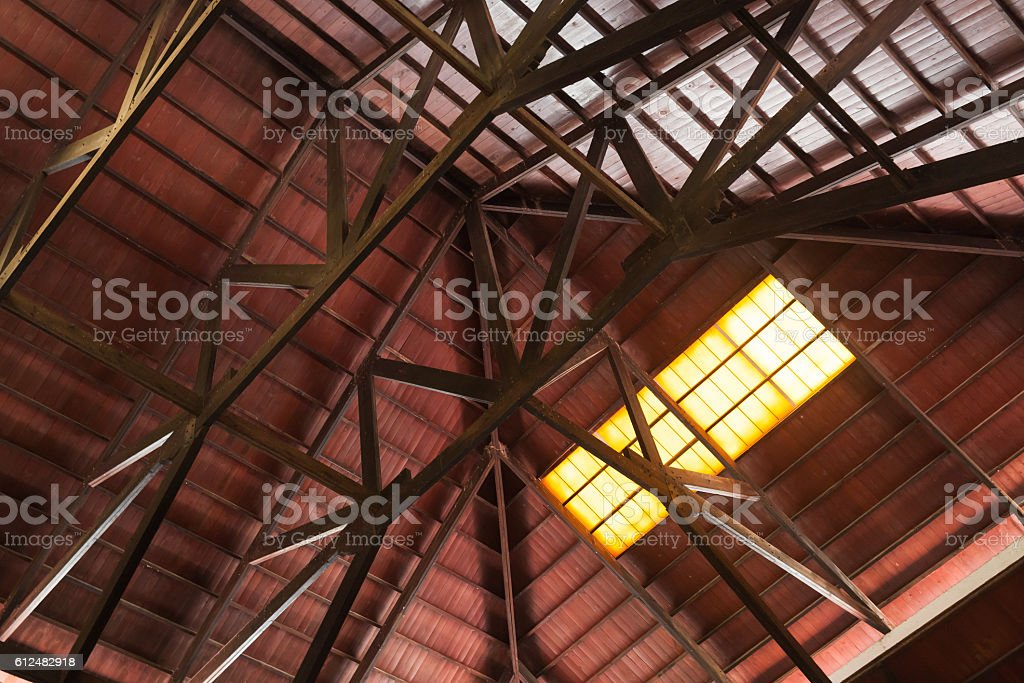 Internal construction of wooden roof with girders stock photo