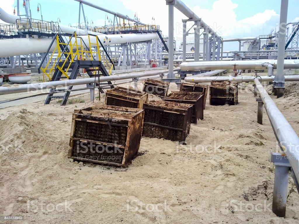 Internal parts of the end divider of the tube phases. Steel plates for better separation of water-oil emulsion. stock photo