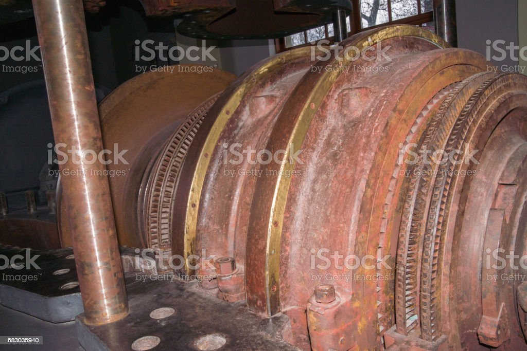 Internal rotor of a steam turbine in an old power plant stock photo