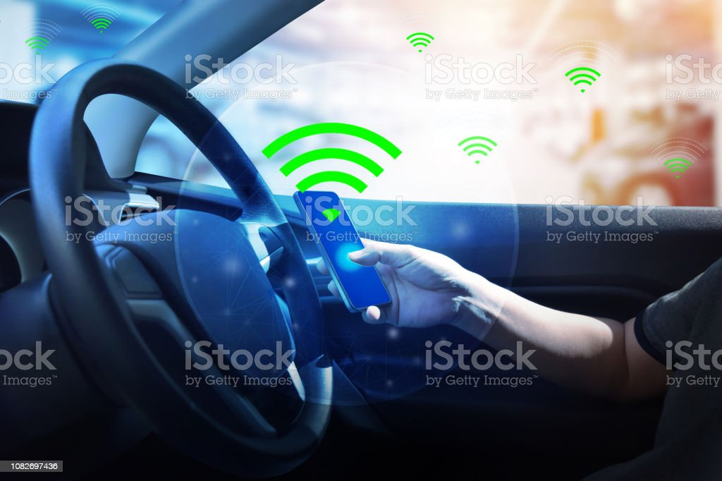 Internal view and automatic self command driving  with smartphone , Electric smart car technology. stock photo