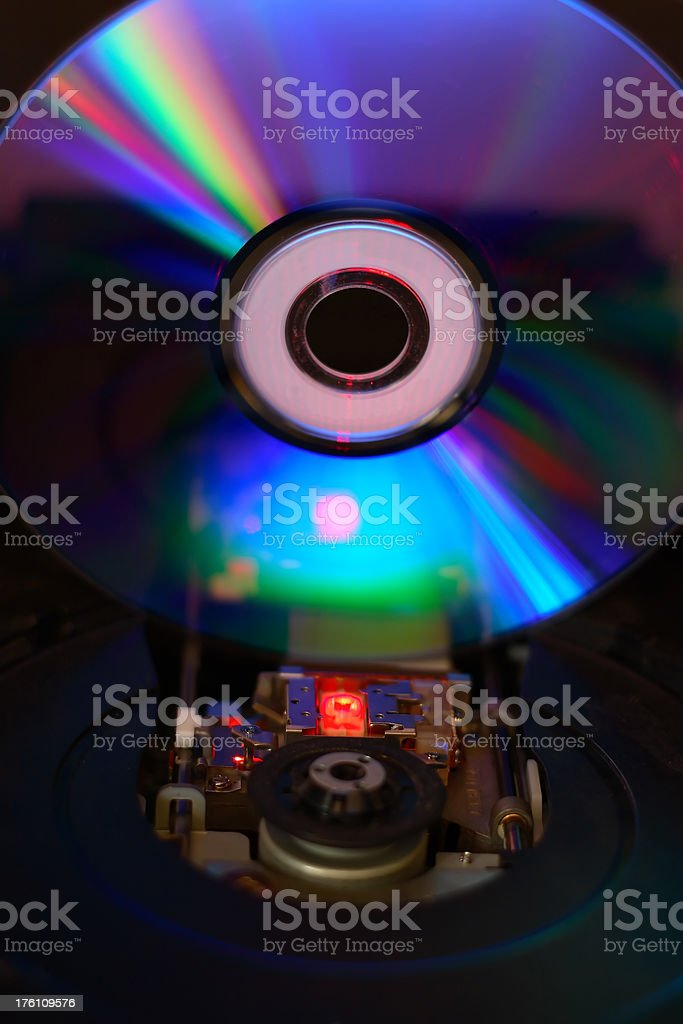 Internal view of a cd in drive with laser illuminated stock photo