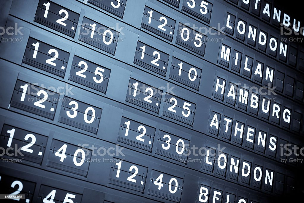 International arrival or departure flight information board stock photo