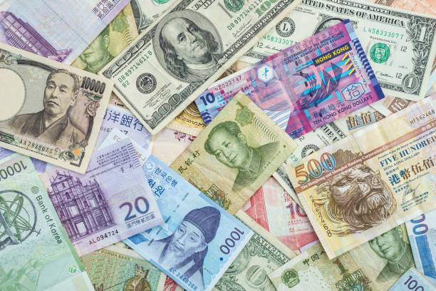 Fundo Internacional das notas para o conceito de moedas globais para o negócio de troca de dinheiro - foto de acervo