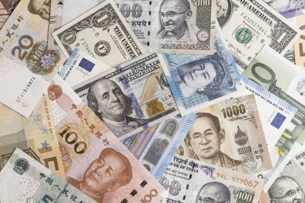 International banknotes from world major countries using as Forex or financial economy background, US dollar, UK pound, Euro, Japanese yen, Indian rupee, Chinese yuan, Thai Baht stock photo