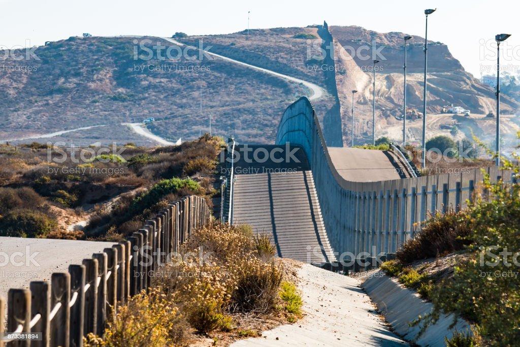 The international border wall between San Diego, California and...