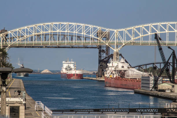 International Bridge With Freighters Waiting To Enter The Soo Locks In Sault Ste Marie Michigan stock photo